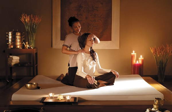 Spa Massage Therapist giving a personalised massage to a customer.