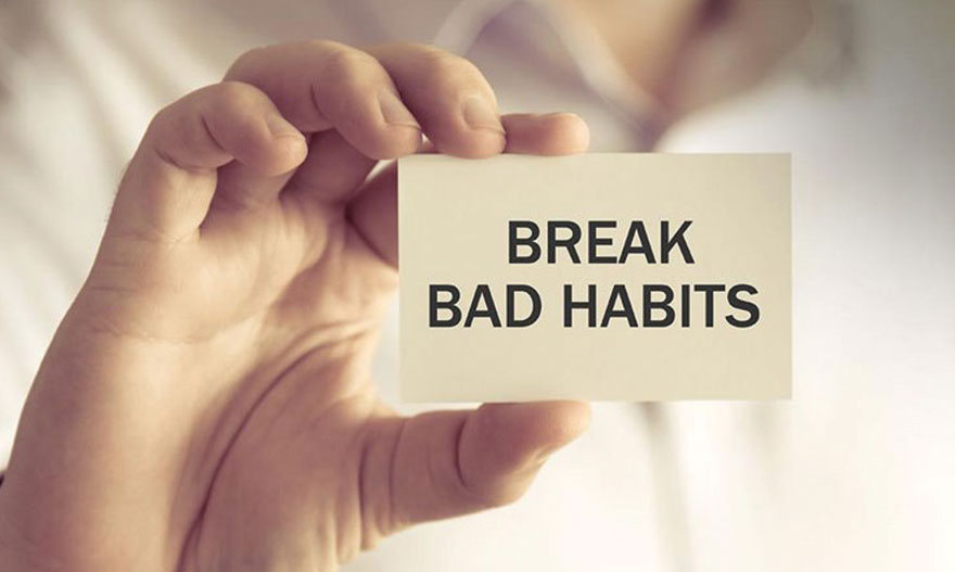 Image of a man holding a note with a message break bad habits