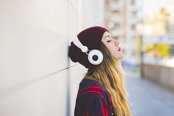 Image of a girl forgets the world while enjoying music