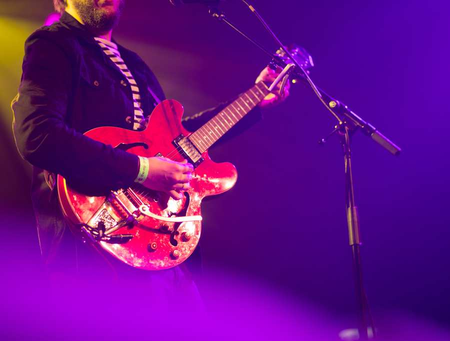 Image showing a man playing guitar in a show