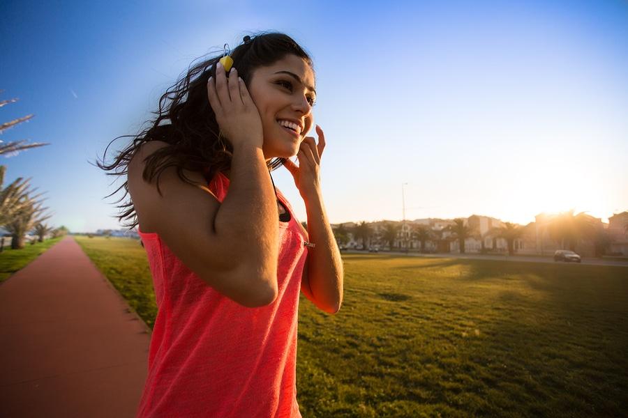 Image showing a smiling girl enjoying music