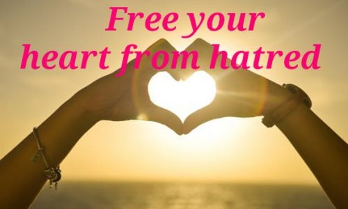 Image Represents Heart Shaped hand with a message heart from hatred