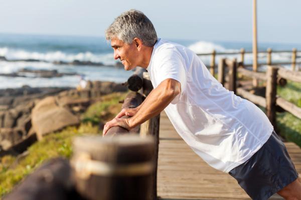 A Senior Man Doing Morning Workouts Near The Beach.