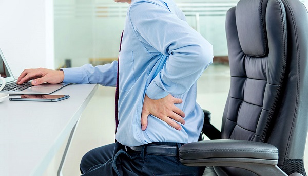 A Corporate Man Having Lower Backpain During His Work.